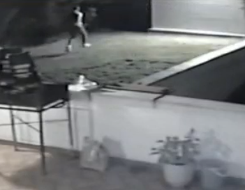 The CCTV footage shows at least three men running towards the large gate and attempting to escape