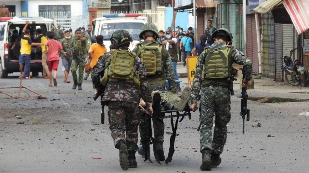 Philippines arrests woman suspected of planning suicide attack