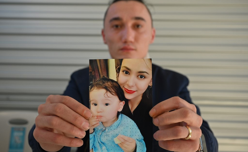 Uighur family freed after three years, and reunited in Australia